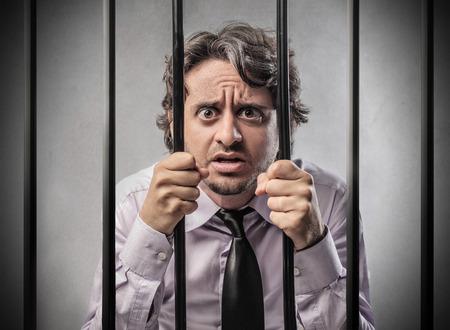 man in jail: Behind bars