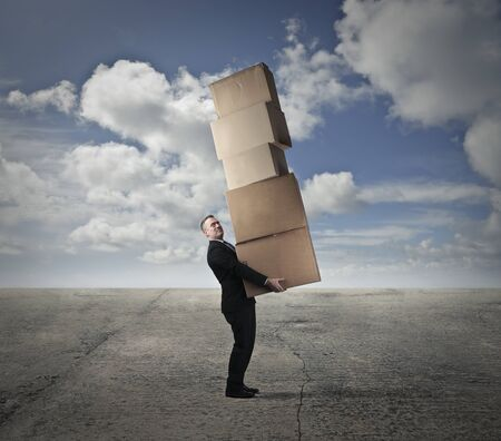 Carrying a pile of boxes photo