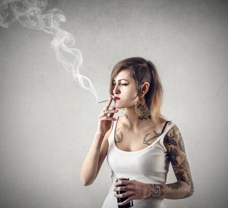 tattoo face: Smocking cigarettes