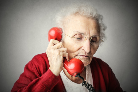 Elderly woman doing a phone call