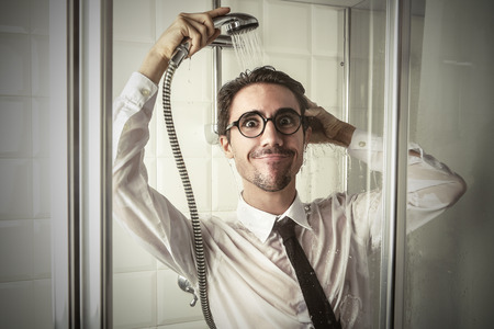 stupor: Businessman in the shower Stock Photo