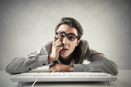 Desperate employee typing on the keyboard Foto de archivo