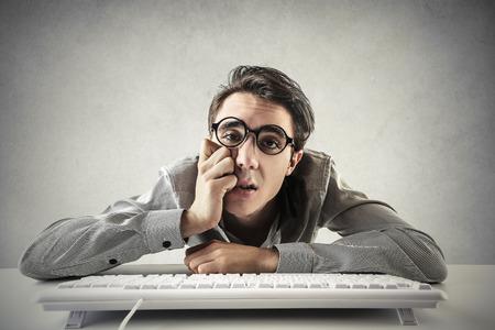 Desperate employee typing on the keyboard Standard-Bild
