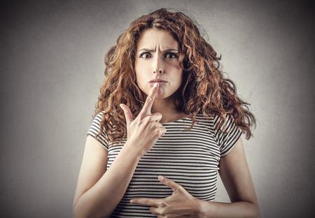 indecision: Doubtful girl Stock Photo