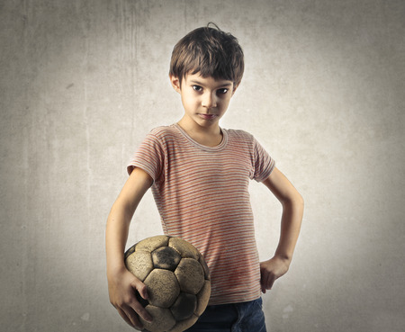 vintage children: Young footballer Stock Photo