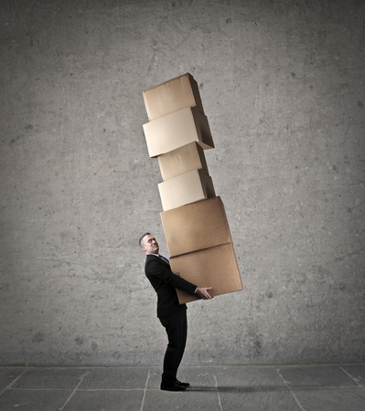 creative force: Carrying heavy boxes Stock Photo