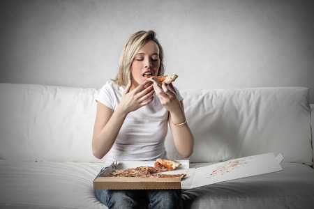 take away: Eating a pizza on the sofa