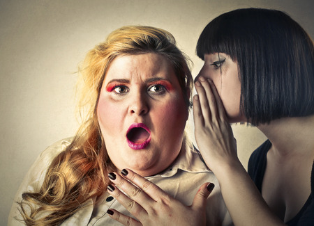 fat girl: Whispering a secret Stock Photo