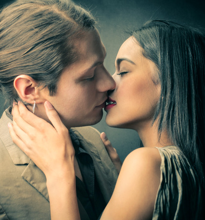 lipstick kiss: Kissing lovers Stock Photo