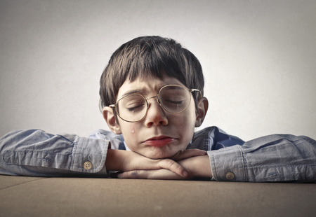poor children: Sad boy Stock Photo