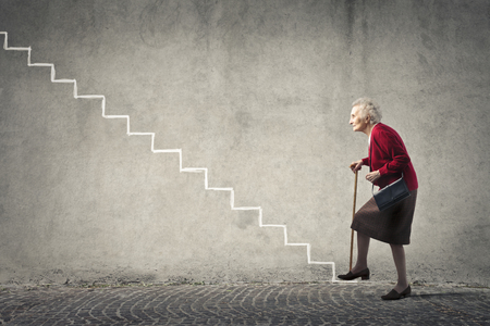 woman on scale: Elderly woman going up the stairs