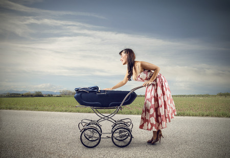 ironic: A walk with the baby Stock Photo