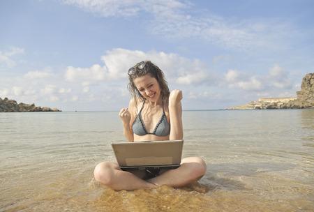 exult: Jubilant girl at the seaside