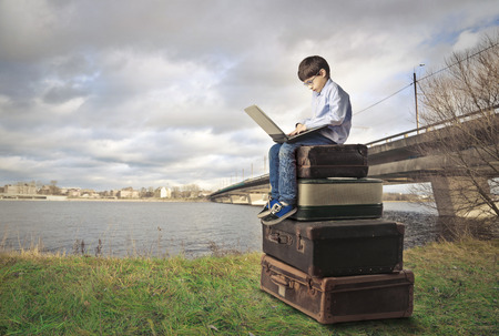 surfing the net: Young boy surfing the Net