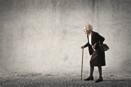 Elderly woman walking Banque d'images