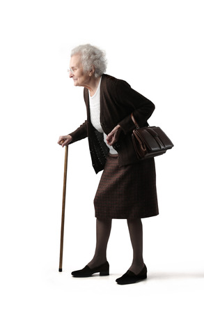 Elderly woman using a stick