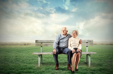 grandparent: Elderly couple sitting on a bench Stock Photo