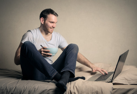 surfing the net: Man surfing the Net
