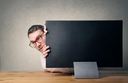 Hiding behind the screen Stockfoto