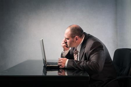 net surfing: Businessman surfing the Net