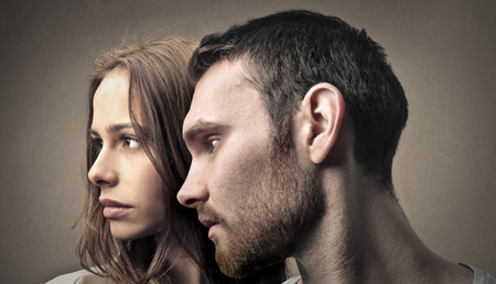 woman face profile: Couple looking away Stock Photo