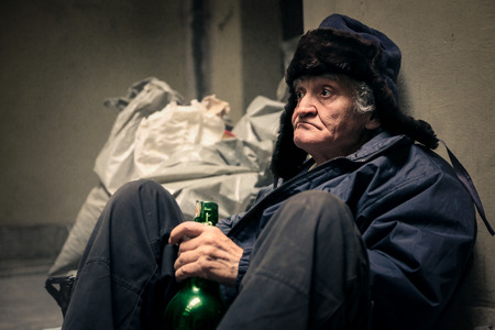homeless: Homeless man drinking