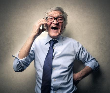 persona llamando: Hombre de negocios hablando por tel?fono Foto de archivo