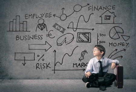 A very young businessman sitting on the ground Stock Photo