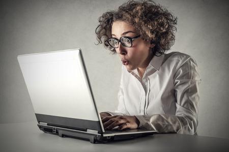 Businesswoman using a pc Stock Photo