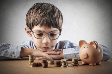 money euro: Child saving money Stock Photo