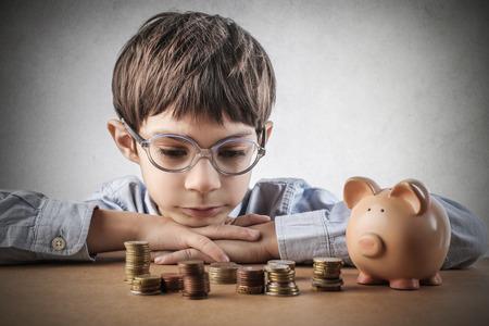 argent: �conomiser de l'argent enfant Banque d'images