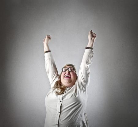 gordos: Mujer jubilating feliz Foto de archivo