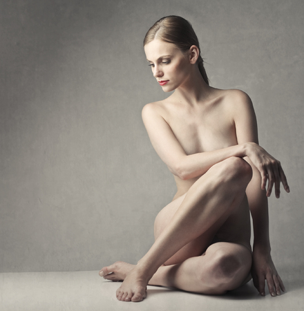 naked woman sitting: Naked girl