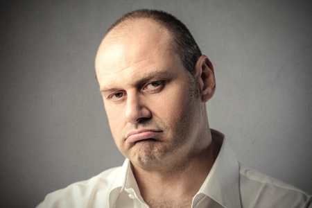 snort: Disappointed man Stock Photo