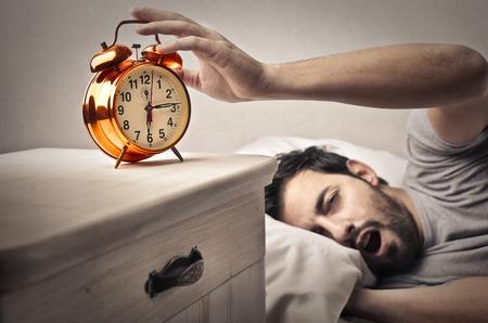 reveille: Sleepy man Stock Photo
