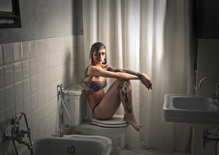 Girl sitting in the bathroom
