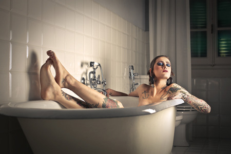 lying in bathtub: Bath tube Stock Photo