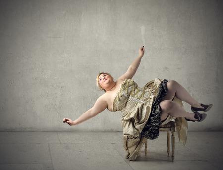 Chubby woman falling down Standard-Bild