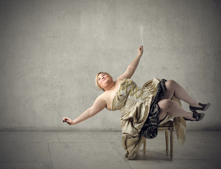 Chubby woman falling down Stock Photo