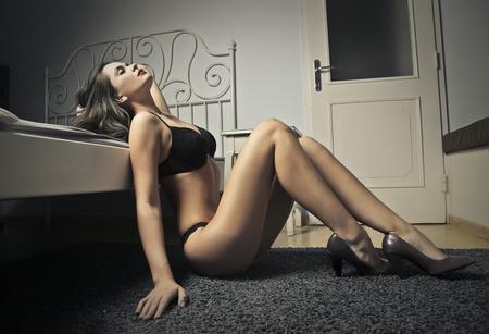 bed sex: Woman wearing black lingerie