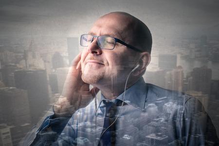 rythm: Businessman listening to music Stock Photo