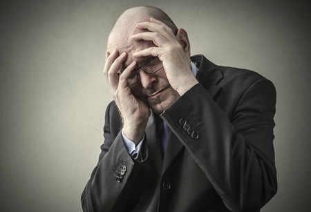 indecision: Businessman regretting his choice