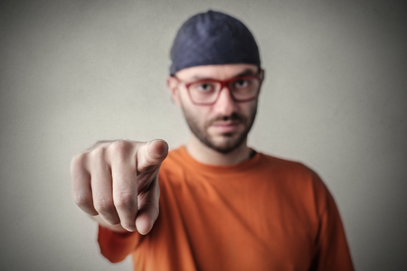 Man pointing at someone Stock Photo