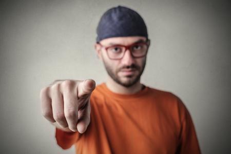 disdain: Man pointing at someone Stock Photo