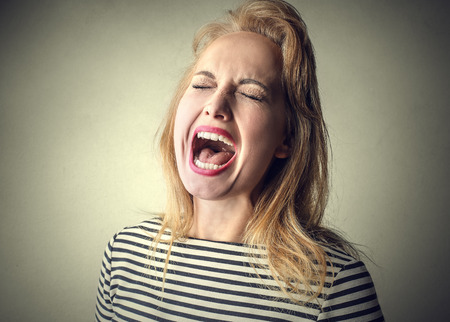 woman shouting: Blonde girl screaming
