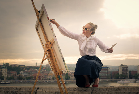 artist's: Woman painting on canvas Stock Photo
