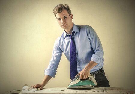 Businessman doing the ironing