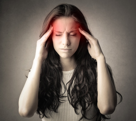 headache pain: Woman suffering from headache
