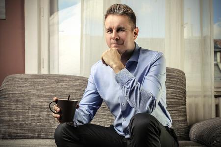 home business: Businessman holding a mug