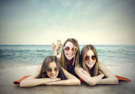 girl lying: Three friends at the beach